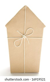 Studio Shot Of House Wrapped In Brown Paper And Tied With String