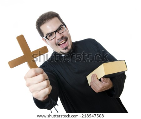 Studio shot of isolated priest showing the cross and screaming