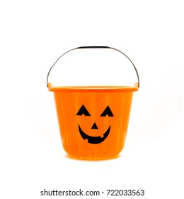 Studio shot Jack O' Lantern Halloween candy bucket isolated on white background. Orange plastic Trick Or Treat candy pail.