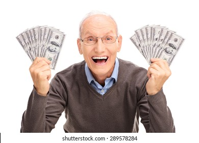 Studio shot of a joyful senior holding money in both hands and looking at the camera isolated on white background