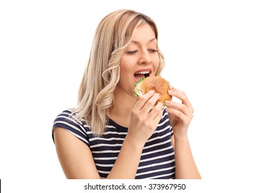 Studio shot of a joyful young woman eating a sandwich isolated on white background