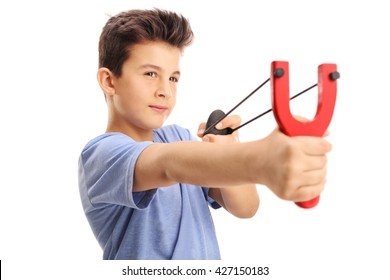 Studio shot of a little boy firing a rock from a slingshot isolated on white background