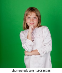 Studio shot of a little girl in a nightgown on green background