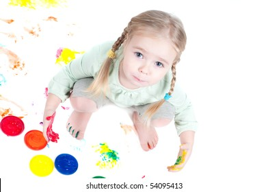 Studio shot of little girl playing with colors