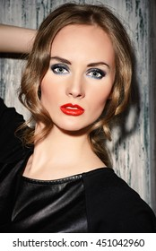 Studio shot of a magnificent young woman in black clothes. Beauty, fashion concept. Make-up, smoky eyes.