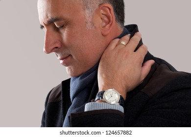 Studio shot of a man with pain in neck