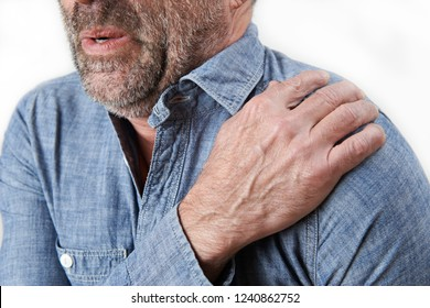 Studio Shot Of Man Suffering With Frozen Shoulder