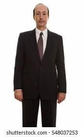 Studio shot of mature businessman isolated against white background