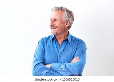 Studio Shot Of Mature Man Against White Background Laughing At Camera