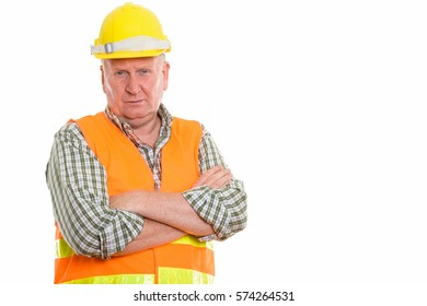 Studio shot of mature man construction worker with arms crossed