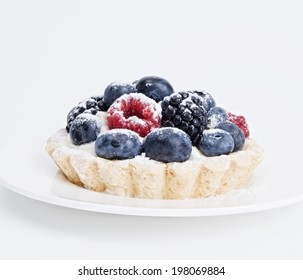 Studio shot of mixed berry mini tart