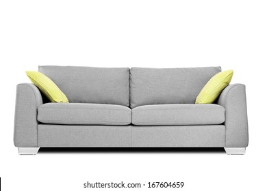 Studio shot of a modern couch with pillows isolated on white background
