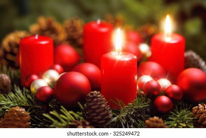 Studio shot of a nice advent wreath with baubles and two burning red candles