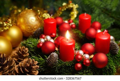 Studio shot of a nice advent wreath with baubles and one burning red candle