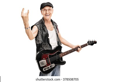 Studio shot of an old punk rocker holding a bass guitar and making a rock gesture isolated on white background