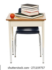 Studio shot on white background of an old metal school desk and chair with books and an apple on it.