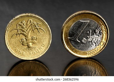 Studio shot of one euro coin and one pound coin