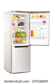 Studio shot of an open fridge full of healthy food products isolated against white background