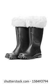 Studio shot of a pair of santa boots isolated against white background