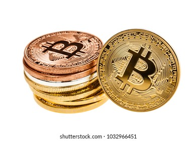 Studio shot of a pile or stack of bitcoin physical golden, silver and copper or bronze coins isolated over a white background. Bitcoin is a blockchain crypto currency