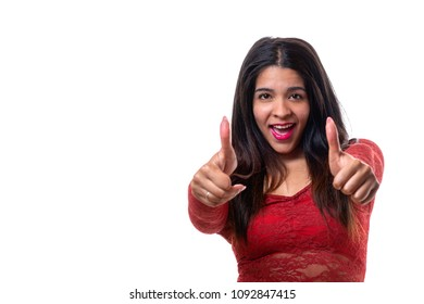Studio shot portrait of a cheerful beautiful woman showing thumbs up against white background for copy space