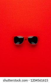 studio shot of red sunglasses. summer is coming concept. vertical orientation
