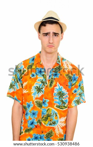 bedadf6e5 Studio shot of sad Caucasian tourist man wearing Hawaiian shirt isolated  against white background