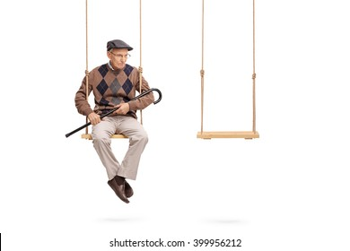 Studio shot of a sad senior sitting on one swing with an empty swing beside him isolated on white background