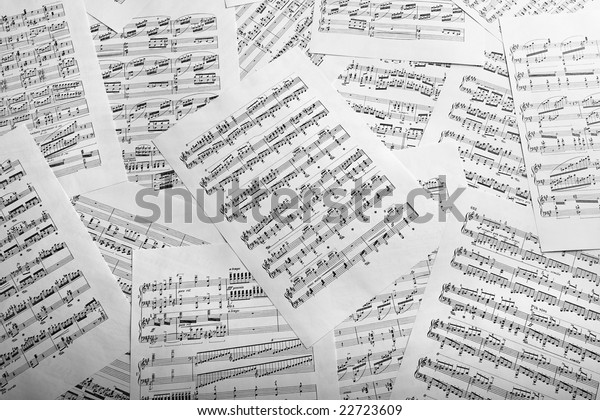 Studio shot of scattered music sheets.