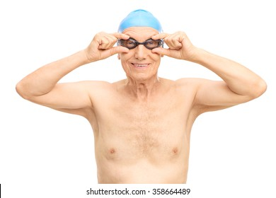 Studio shot of a senior man with a blue swim cap and black swimming goggles isolated on white background