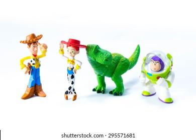 Studio Shot of  Sheriff Woody, Jessie, Rex the green dinosaur, and Buzz Lightyear robot toy character from Toy Story.