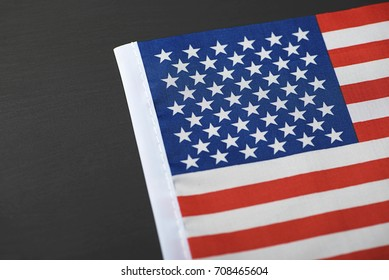 Studio shot of small bright USA flag on black background. Copy space.