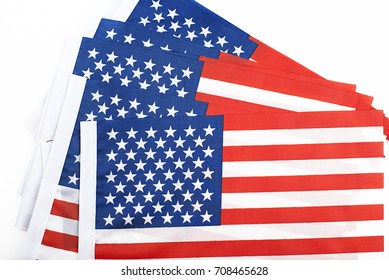 Studio shot of small bright USA flag lying on white background. Isolated.