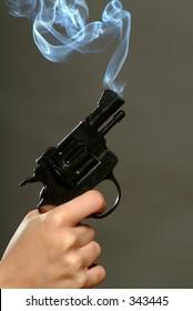 Studio shot of smoking pistol