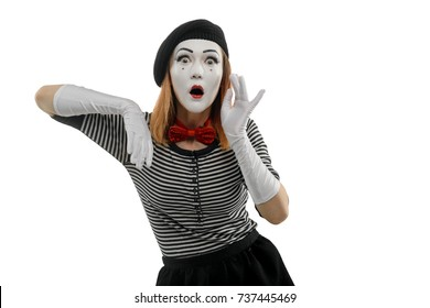 Studio shot of surprised woman, isolated on white. Female mime artist is leaning on imaginary box, monkeying a woman who loves gossip. Pantomime concept.