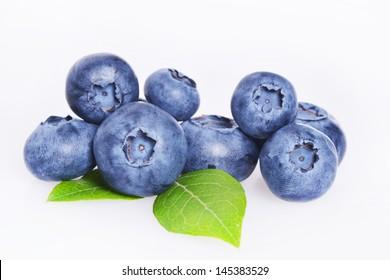 Studio shot of tasty blueberries and green leaf