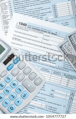 form 1040 calculator  Studio Shot Tax Form 12 Calculator Stock Photo (Edit Now ...