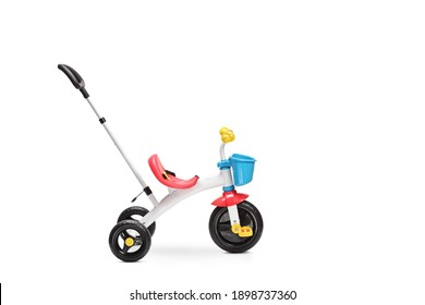 Studio shot of a tricycle for toddlers with a pushing handle isolated on white background