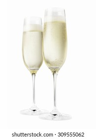 Studio shot of two champagne glasses isolated on a white background.