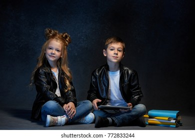 Studio shot of two children with laptop