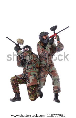 Studio shot of two paintball players isolated in white background
