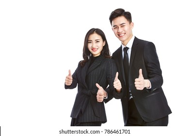 studio shot of two young asian corporate executive, businessman and businesswoman, showing the two-thumbs-up sign, looking at camera smiling, isolated on white background.