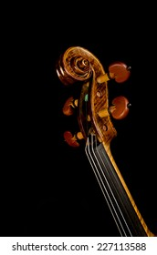 Studio shot of a violin neck isolated on black