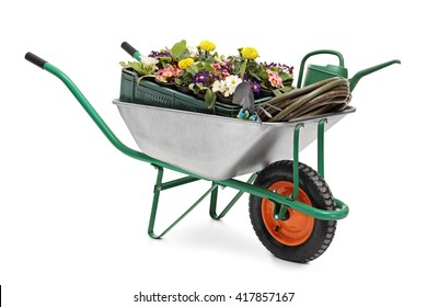 Studio shot of a wheelbarrow full of gardening equipment and flowers isolated on white background