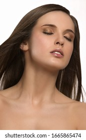 Studio shot of woman with bare shoulders and eyes closed