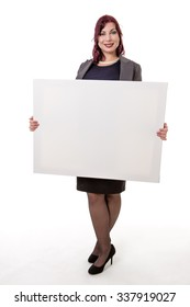 Studio shot of a woman in a business suit holding a blank card to display a message