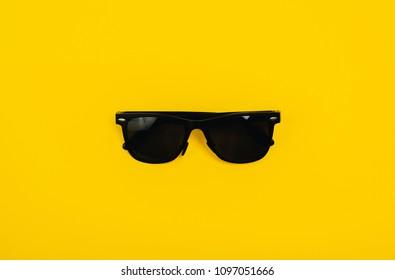 studio shot of yellow sunglasses. summer is coming concept
