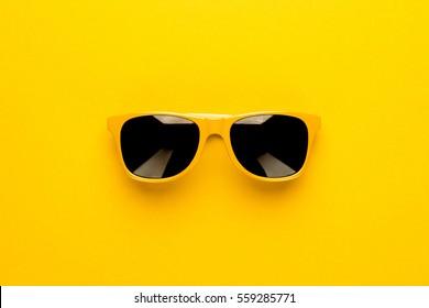 studio shot of yellow sunglasses. summer is coming concept - Shutterstock ID 559285771