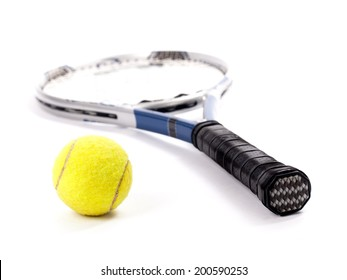 Studio shot of a yellow tennis ball and racket isolated on a white background