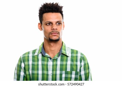 Studio shot of young African man thinking